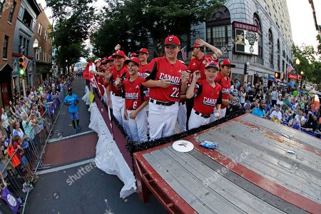 Baseball Hall of Famer Randy Johnson rides as the Grand Marshall of the Little League Grand Slam Parade in downtown Williamsport, Pa., . The Little League World Series baseball tournament, featuring 16 teams from around the world, starts August 14, 2019 in South Williamsport, Pa