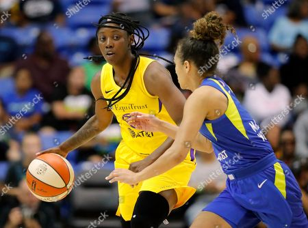 Stock Picture of Brooke McCarty-Williams, Alexis Jones. Los Angeles Sparks guard Alexis Jones, left, advances the ball up court as Dallas Wings' Brooke McCarty-Williams, right, defends in the first half of a WNBA basketball game in Arlington, Texas