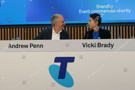 Telstra CEO Andrew Penn (L) and new CFO Vicky Brady (R) converse during a press conference at Telstra headquarters in Melbourne, Australia, 15 August 2019. Telstra has reported a 40 percent fall in full-year profit to 2.15 billion Australian dollar (around 1.45 billion US dollar) and flagged another earnings squeeze next year as construction of the national broadband network nears completion.