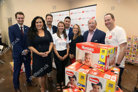 Phillip Vander Klay, of National Diaper Bank Network, Assemblywoman Lorena Gonzalez, Blake Young, of the Sacramento Food Bank and Family Services, Christine Derck, from Huggies, Derek Rodriguez, with Walgreens, Jessica Bartholow, Denny Belcastro, with Kimberly-Clark, and Greg Kearns, with Huggies, left to right, gathered to celebrate a donation of 250,000 diapers to the Sacramento Food Bank and Family Services on in Sacramento, Calif