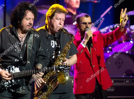 Stock Picture of Steve Lukather, Warren Ham, Ringo Starr. Steve Lukather, left, Warren Ham and Ringo Starr perform in concert with Ringo Starr and His All Starr Band at The Met, in Philadelphia