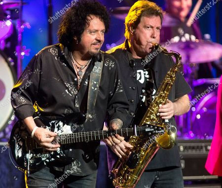 Steve Lukather, Warren Ham. Steve Lukather, left, and Warren Ham perform in concert with Ringo Starr and His All Starr Band at The Met, in Philadelphia