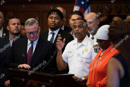 Philadelphia Police Commissioner Richard Ross, center right, speaks during a news conference at City Hall in Philadelphia, . A gunman, identified as Maurice Hill, wounded six police officers before surrendering early Thursday, after a 7 ½-hour standoff