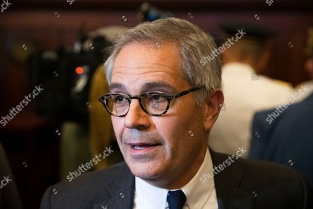 Philadelphia District Attorney Larry Krasner speaks with members of the media at City Hall in Philadelphia, . A gunman, identified as Maurice Hill, wounded six police officers before surrendering early Thursday, after a 7 ½-hour standoff
