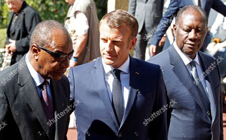 French President Emmanuel Macron, Ivory Coast's President Alassane Ouattara and Guinean President Alpha Conde attend a ceremony marking the 75th anniversary of the Allied landings in Provence in World War Two which helped liberate southern France, in Boulouris, France, 15 August 2019.