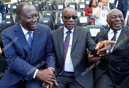 Ivory Coast's President Alassane Ouattara (C) and Guinean President Alpha Conde (L) attend a ceremony marking the 75th anniversary of the Allied landings in Provence in World War Two which helped liberate southern France, in Boulouris, France, 15 August 2019.