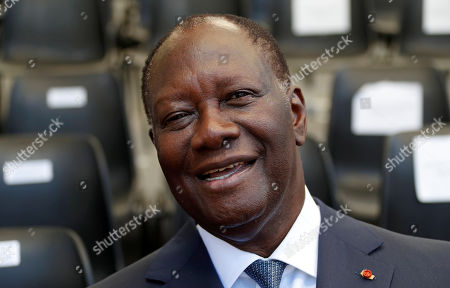 Ivory Coast's President Alassane Ouattara reacts during a ceremony marking the 75th anniversary of the Allied landings in Provence in World War Two which helped liberate southern France, in Boulouris, France, 15 August 2019.