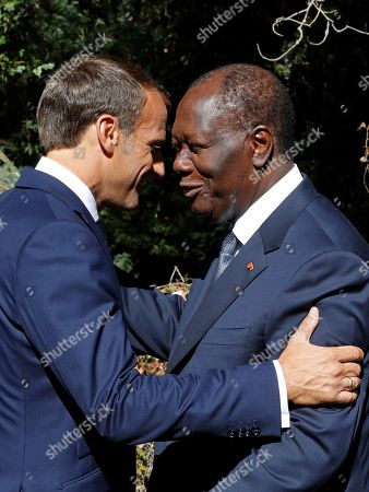 French President Emmanuel Macron (L) welcomes Ivory Coast's President Alassane Ouattara (R) at at a ceremony marking the 75th anniversary of the Allied landings in Provence in World War Two which helped liberate southern France, in Boulouris, France, 15 August 2019.