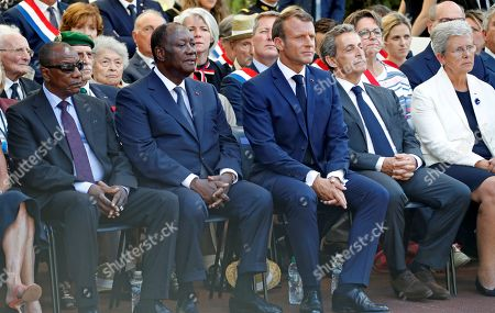 (L-R) Guinean President Alpha Conde, Ivory Coast's President Alassane Ouattara, French President Emmanuel Macron, and former French president Nicolas Sarkozy attend a ceremony marking the 75th anniversary of the Allied landings in Provence in World War Two which helped liberate southern France, in Boulouris, France, 15 August 2019.