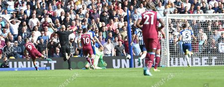 Chicharito of West Ham (far left) scores their first goal during the Premier League match between Brighton and Hove Albion and West Ham United at the American Express Community Stadium , Brighton , 17 August 2019