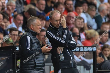 18th August 2019 , Bramall Lane, Sheffield, England; Premier League Football, Sheffield United vs Crystal Palace ; Chris Wilder manager of Sheffield United and Alan Knill talk tactics  Credit: Mark Cosgrove/News Images English Football League images are subject to DataCo Licence