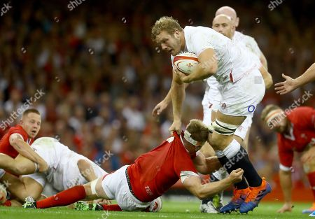 Joe Launchbury of England is tackled by James Davies of Wales