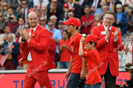 Andrew Strauss comes out on to the pitch wih his sons for Ruth Strauss day during the International Test Match 2019 match between England and Australia at Lord's Cricket Ground, St John's Wood