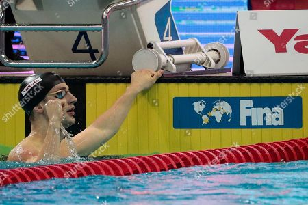 Stock Image of Andrew Wilson of the USA reacts after the Men's 100m Breaststroke Finals of the FINA Swimming World Cup held at the OCBC Aquatic Centre in Singapore, 15 August 2019.