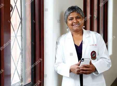 Dr. Manisha H. Shah stands outside her office at the Ohio State University, in Columbus, Ohio. Regardless of her reputation as a performer, Aretha Franklin's cancer doctors say she was no diva as a patient. Shah and Dr. Philip Philip say she didn't demand star treatment and was keen on doing whatever needed to be done. She also wanted to keep her music going as long as possible, which also impressed them