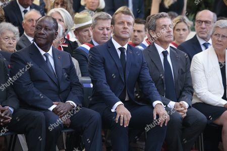 President Alassane Ouattara, French President Emmanuel and Nicolas Sarkozy during a ceremony marking the 75th anniversary of the Allied landings in Provence during World War II