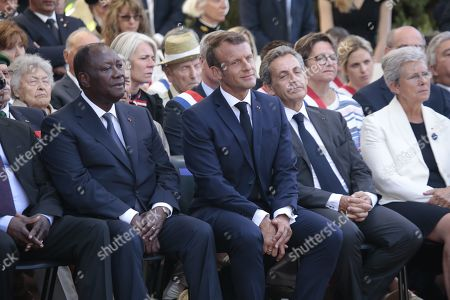 Stock Photo of President Alassane Ouattara, French President Emmanuel and Nicolas Sarkozy during a ceremony marking the 75th anniversary of the Allied landings in Provence during World War II