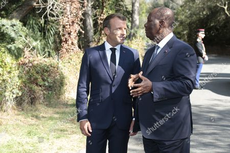 French President Emmanuel Macron and President Alassane Ouattara during a ceremony marking the 75th anniversary of the Allied landings in Provence during World War II