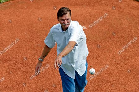 Baseball Hall of Fame pitcher Randy Johnson throws out a ceremonial first pitch during the opening ceremony of the 2019 Little League World Series tournament in South Williamsport, Pa