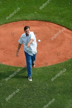 Baseball Hall of Fame pitcher Randy Johnson stands on the mound before throwing out a ceremonial first pitch during the opening ceremony of the 2019 Little League World Series tournament in South Williamsport, Pa