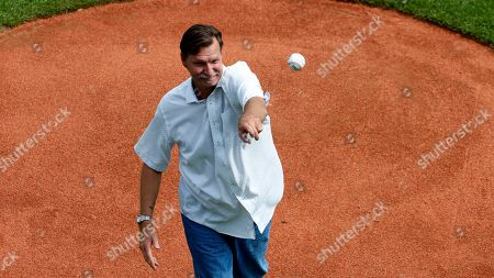 Stock Picture of Baseball Hall of Fame pitcher Randy Johnson throws out a ceremonial first pitch during the opening ceremony of the 2019 Little League World Series tournament in South Williamsport, Pa