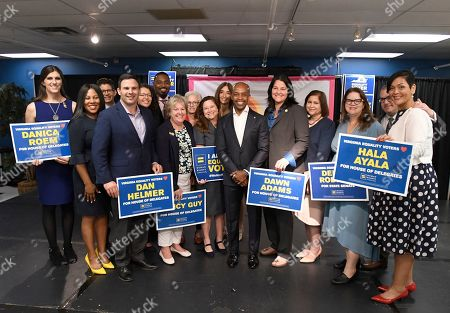 Alphonso David, newly-installed president of the Human Rights Campaign (HRC), center, stands with endorsed candidates, including Danica Roem, Sheila Bynum-Coleman, second from left, Dan Helmer, fourth from left, during a news conference to announce HRC's historic endorsement of 27 pro-equality candidates across Virginia on in Richmond, Va