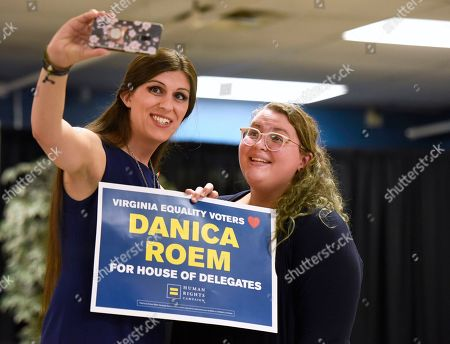 Virginia Delegate Danica Roem, left, takes a selfie with Natalie Landin, of Charlottesville, Va., after a news conference to announce the Human Rights Campaign's historic endorsement of 27 pro-equality candidates across Virginia on in Richmond, Va