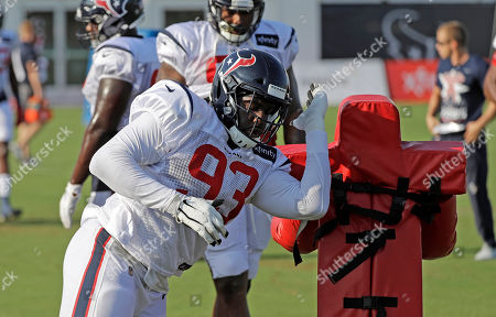 Stock Image of Houston Texans defensive end Joel Heath goes through a drill during a joint NFL training camp football practice with the Detroit Lions, in Houston