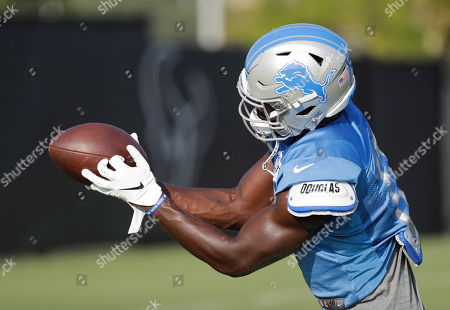 Detroit Lions wide receiver Andy Jones catches a pass during a joint NFL training camp football practice with the Houston Texans, in Houston