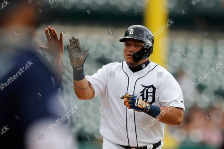 Detroit Tigers designated hitter Miguel Cabrera is greeted by third base coach Dave Clark after a solo home run during the fourth inning of a baseball game against the Seattle Mariners, in Detroit