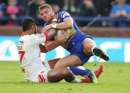 Leeds Rhinos' Jack Walker is tackled by St Helens' Dominique Peyroux