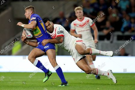 Leeds Rhinos' Jack Walker is tackled by St Helens' Zeb Taia
