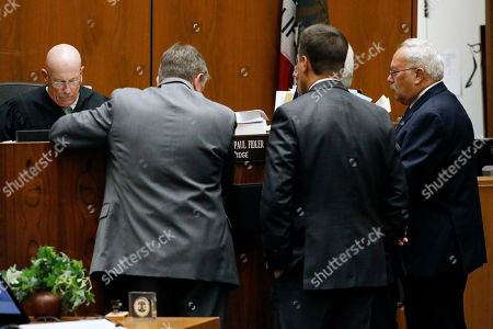 Defense attorneys and prosecutors talk with judge Larry Fidler during the verdict at the Clara Shortridge Foltz Criminal Justice Center in Los Angeles, California, USA, 15 August 2019. Michael Gargiulo, also called the 'Hollywood Ripper', has been found guilty on all counts and two first degree murders.