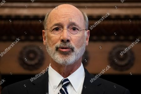 Gov. Tom Wolf speaks during a news conference at City Hall in Philadelphia, . A gunman, identified as Maurice Hill, wounded six police officers before surrendering early Thursday, after a 7 ½-hour standoff