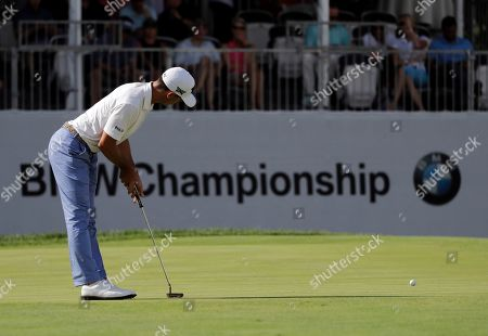 Billy Horschel reacts after missing a putt on the 18th green during the first round of the BMW Championship golf tournament at Medinah Country Club, in Medinah, Ill