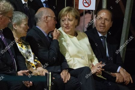 German Chancellor Angela Merkel  (2-r) speaks to former Bundestag President Norbert Lammert (3-R), during a Grand Tattoo military ceremony in honor of Von der Leyen at the Ministry of Defense in Berlin, Germany, 15 August 2019. Von der Leyen was awarded the honor of a Grand Tattoo after serving as German Defense Minister from 17 December 2013 to 17 July 2019. She will assume the office of President of the European Commission on 01 November 2019.