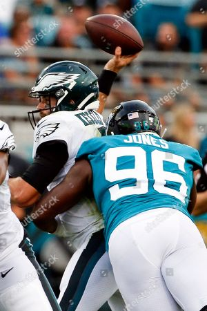 Jacksonville Jaguars defensive end Datone Jones (96) tackles Philadelphia Eagles quarterback Cody Kessler, left, as he tries to throws a pass during the first half of an NFL preseason football game, in Jacksonville, Fla. Kessler was injured on the play