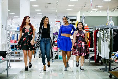 Olympic gold medalist Gabby Douglas, second from left, joins a group of Step Up Dallas students for a shopping spree at JCPenney to help them prepare for the school year ahead in Dallas