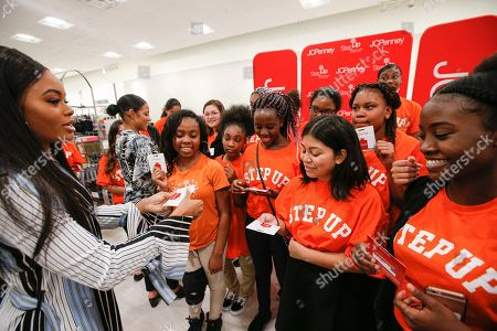 Olympic gold medalist Gabby Douglas hands out $500 JCPenney gift cards to deserving teens from Step Up Dallas to help them head back to school with confidence in Dallas