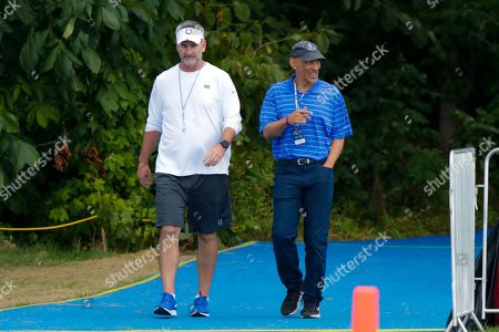 Stock Photo of Frank Reich, Tony Dungy. Indianapolis Colts head coach Frank Reich walks to the field with former Colts coach Tony Dungy practice at the NFL team's football training camp in Westfield, Ind., . The Colts held a joint practice with the Cleveland Browns