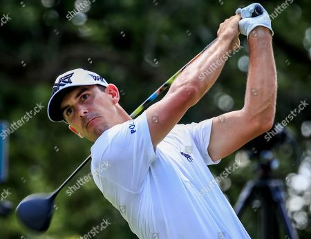 Stock Image of Billy Horschel of the USA hits his tee shot on the fourth hole during the first round of the BMW Championship at Medinah Country Club in Medinah, Illinois, USA, 15 August 2019. The BMW Championship is the second of three playoff tournaments to determine the FedEx Cup champion.