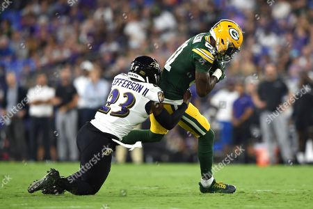 Stock Image of Green Bay Packers wide receiver Geronimo Allison (81) is tackled by Baltimore Ravens strong safety Tony Jefferson (23) during the first half of a NFL football preseason game, in Baltimore