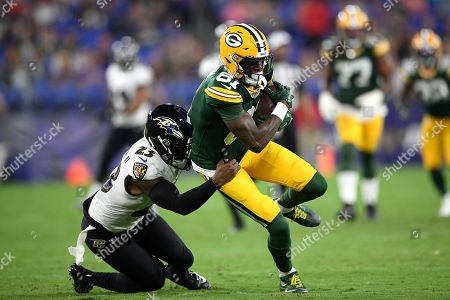 Green Bay Packers wide receiver Geronimo Allison (81) is tackled by Baltimore Ravens strong safety Tony Jefferson (23) during the first half of a NFL football preseason game, in Baltimore