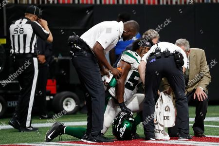 New York Jets inside linebacker Avery Williamson (54) speaks to medical personel after injury against the Atlanta Falcons during the first half an NFL preseason football game, in Atlanta