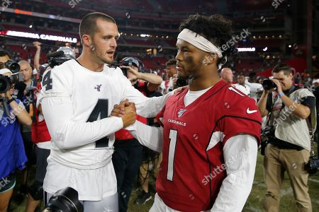 Stock Picture of Arizona Cardinals punter Andy Lee (4) and Arizona Cardinals quarterback Kyler Murray (1) meet at midfield after an an NFL preseason football game, in Glendale, Ariz. The Raiders won 33-26