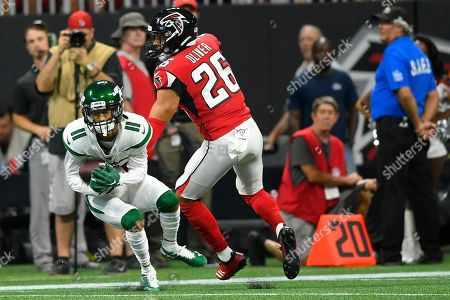 New York Jets wide receiver Robby Anderson (11) makes a catch ahead of Atlanta Falcons free safety Isaiah Oliver (26) during the first half an NFL preseason football game, in Atlanta