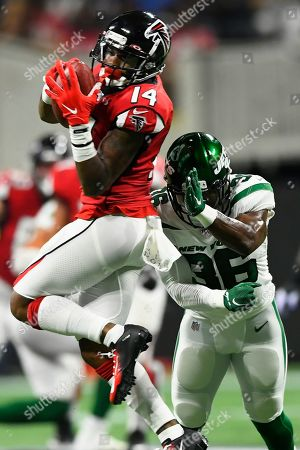 Atlanta Falcons wide receiver Justin Hardy (14) makes the catch against New York Jets defensive end Henry Anderson (96) during the first half an NFL preseason football game, in Atlanta