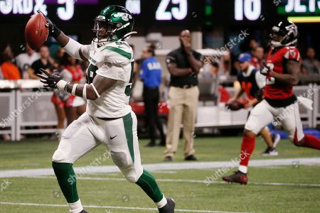 New York Jets outside linebacker James Burgess (58) runs the ball into the end zone for a touchdown against the Atlanta Falcons during the second half an NFL preseason football game, in Atlanta