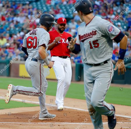 Jason Castro, Jake Cave, Pedro Payano. Minnesota Twins' Jason Castro (15) looks back to see Jake Cave (60) score on a fielders choice by Max Kepler as Texas Rangers starting pitcher Pedro Payano, rear, looks on in the second inning of a baseball game in Arlington, Texas, . Castro scored on the same play
