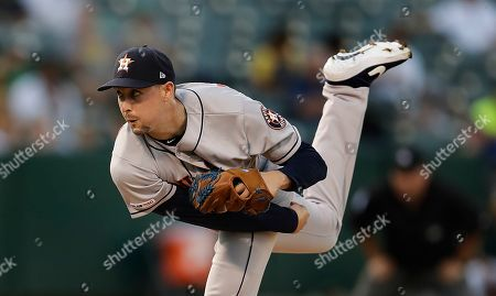 Houston Astros pitcher Aaron Sanchez works against the Oakland Athletics during the first inning of a baseball game, in Oakland, Calif